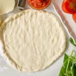 This Pizza Dough is quick and easy! The perfect crust for the toppings you love.
