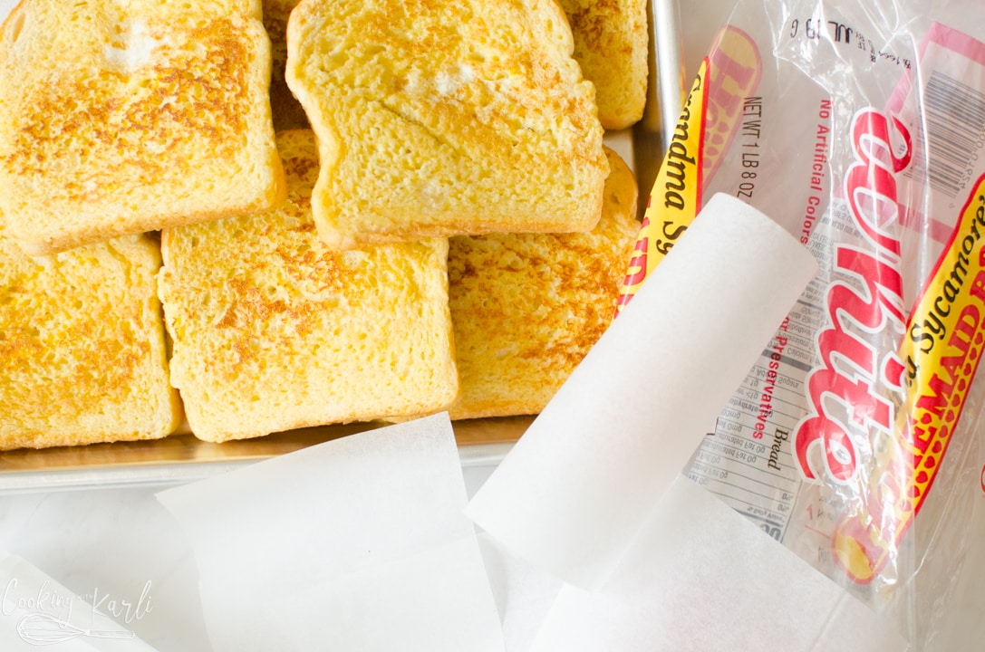 cool French toast, parchment paper squares and empty bread bag.