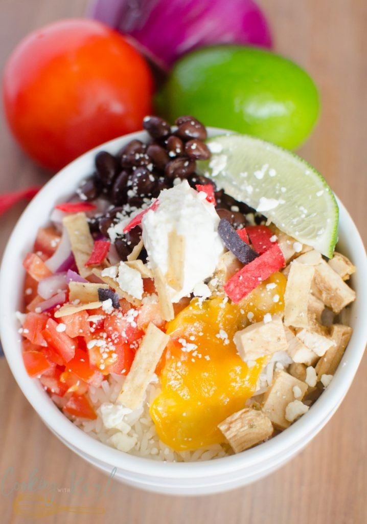 Chicken Burrito Bowls are everything you love about a burrito, with the ease of throwing everything in the bowl. The rice, beans, cheese, seasoned chicken, salsa, sour cream and cilantro are tossed together to make a quick, easy and customizable dinner.