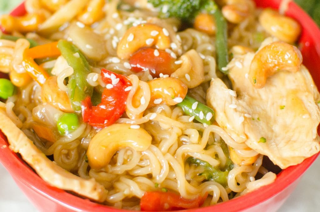 Instant Pot Cashew Chicken and Noodles is finished in no time, literally zero minutes on high pressure! The ramen noodles soak up the sweet sauce that perfectly pairs the veggies, cashews and chicken.