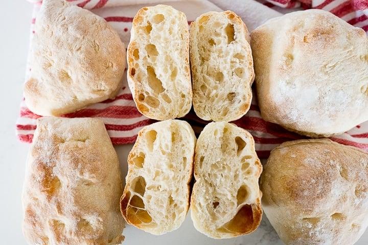 homemade ciabatta roll recipe, finished, cut in half to show crumb.