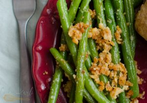 Garlic Parmesan Green Beans are the perfect side to any dish, the garlic and crisp parmesan crumbles take these green beans to the next level.