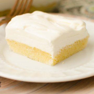 Vanilla lush cake is a served cold layered dessert.