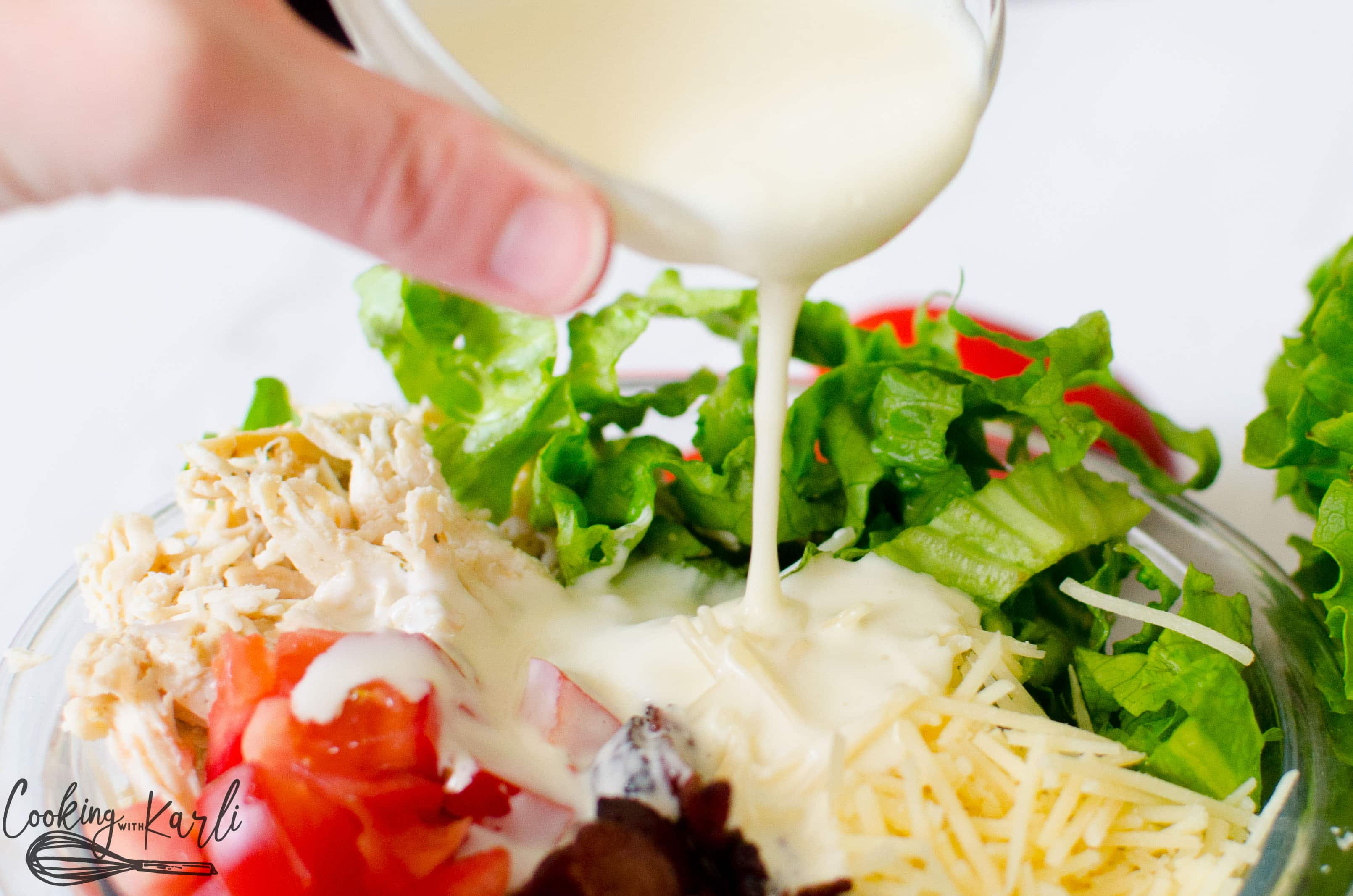 Homemade Creamy dressing that brings the BLT chicken wrap together.