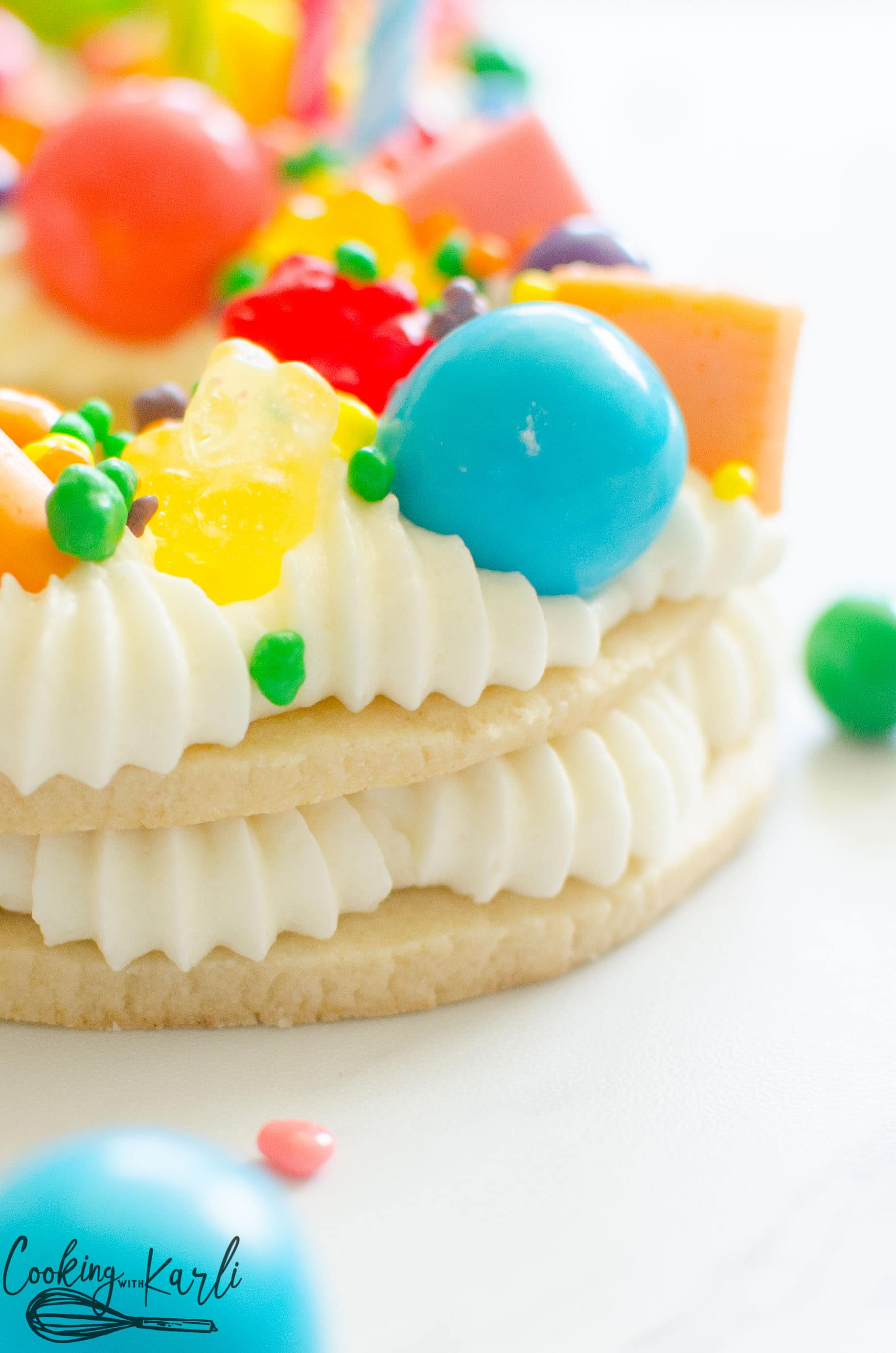 Gumballs, gummy bears and nerds top the vanilla butter cream sugar cookie birthday cake.