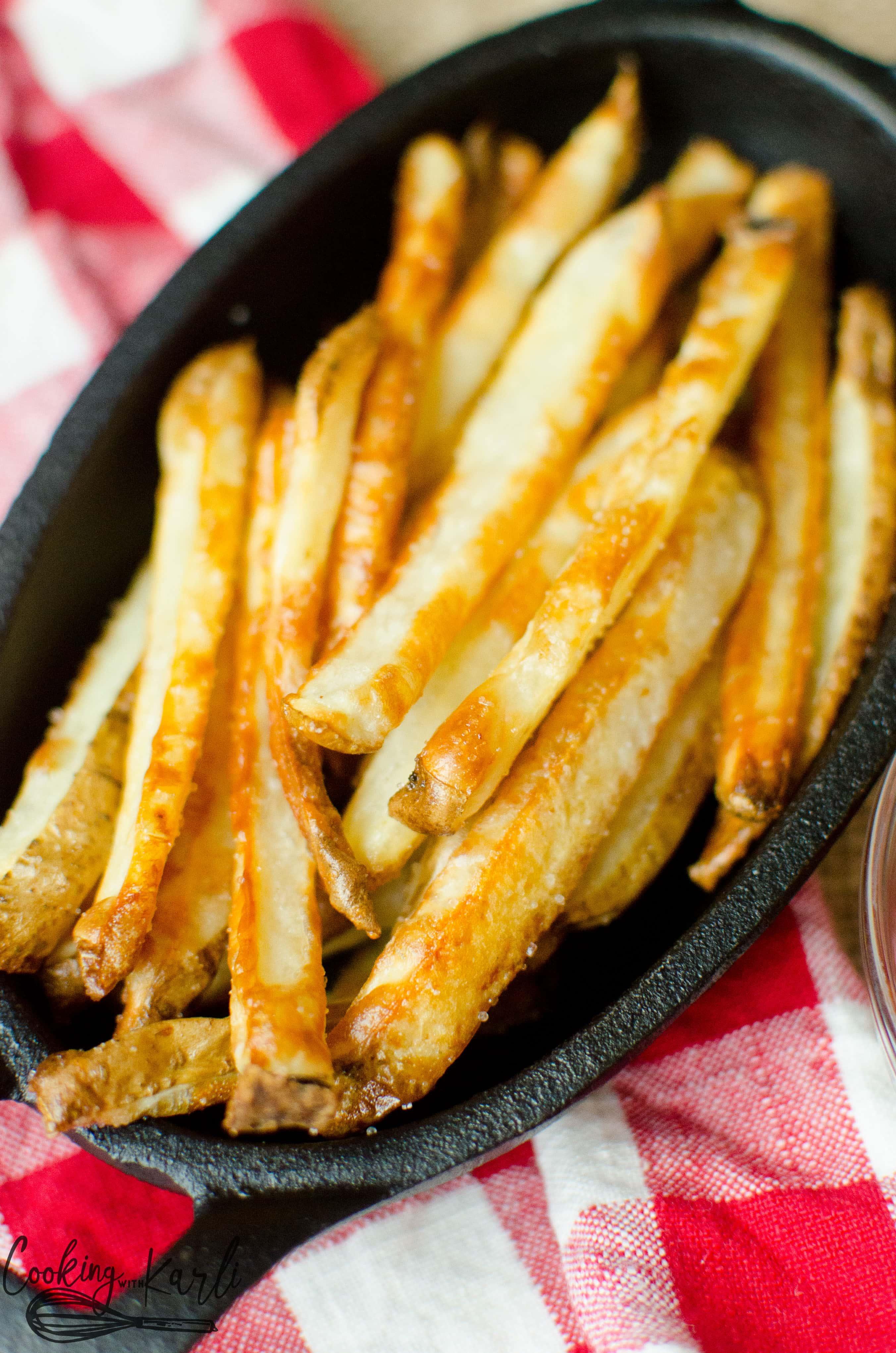 Bowl full of easy, crispy oven baked french fries