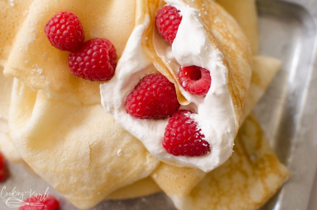 crepes made with pancake mix with whipped cream and raspberries