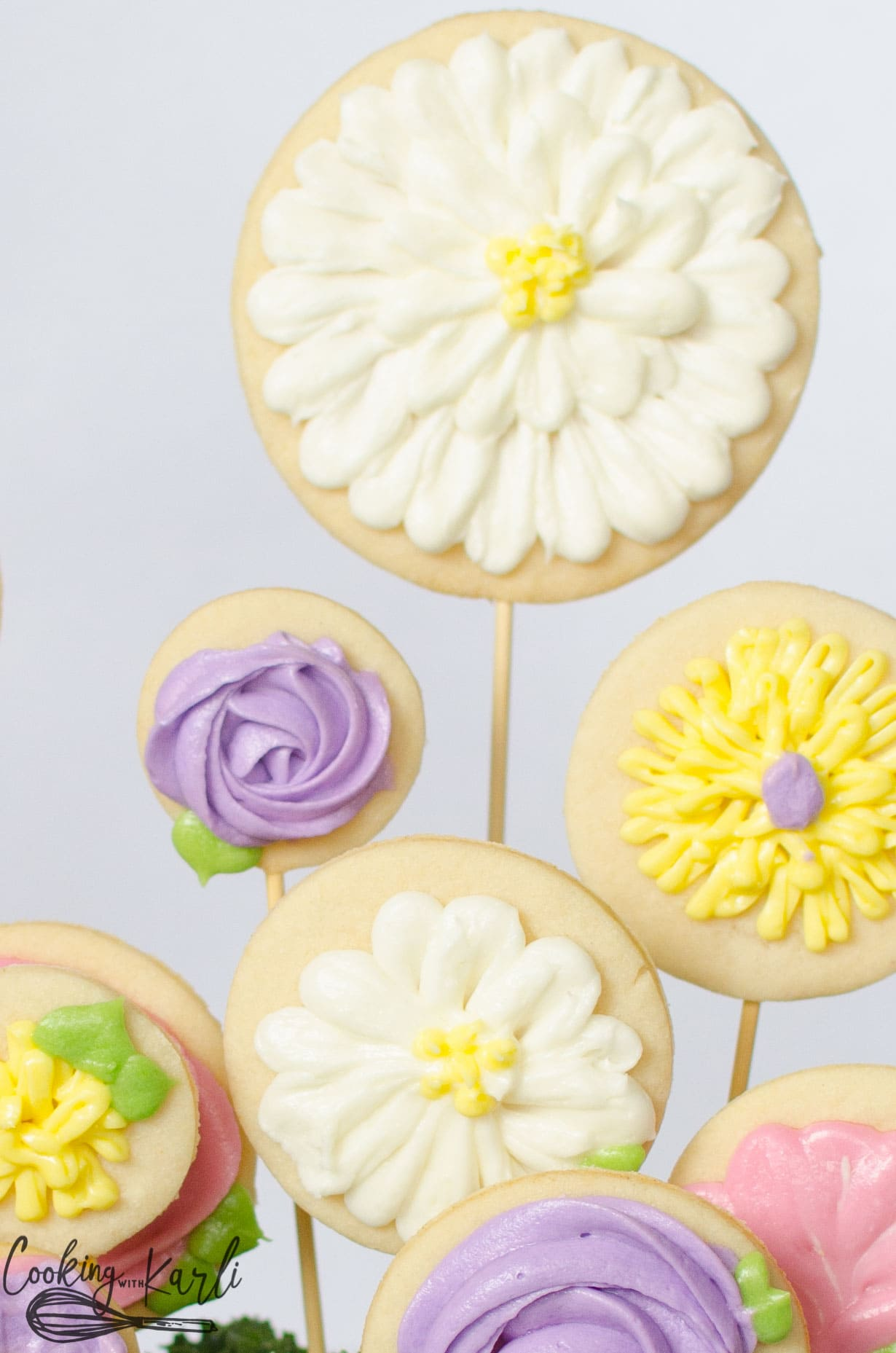 Sugar cookies baked onto kabob sticks to make a flower garden gift.