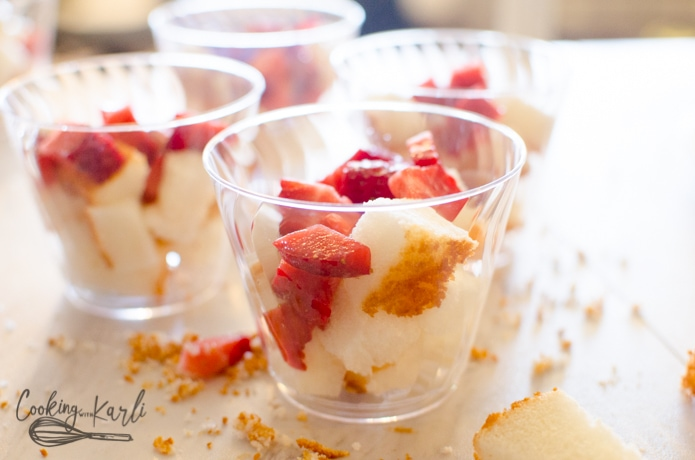 Strawberries top the angel food cake in the individual cups.