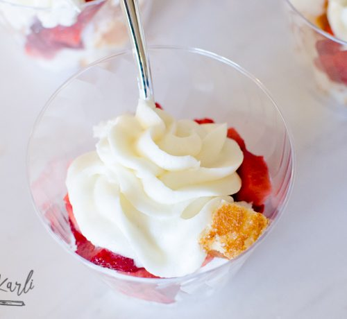 Angel food cake, sliced strawberries and vanilla buttercream served individually in a cup