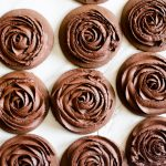 Chocolate roll and cut cookies decorated with chocolate buttercream
