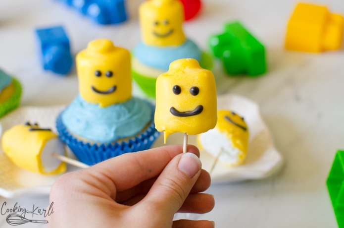 Marshmallow covered in chocolate make perfect edible lego heads