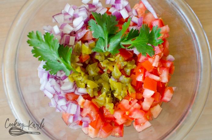 tomatoes, onion, jalapeños and cilantro mixed together to make pico de Gallo.