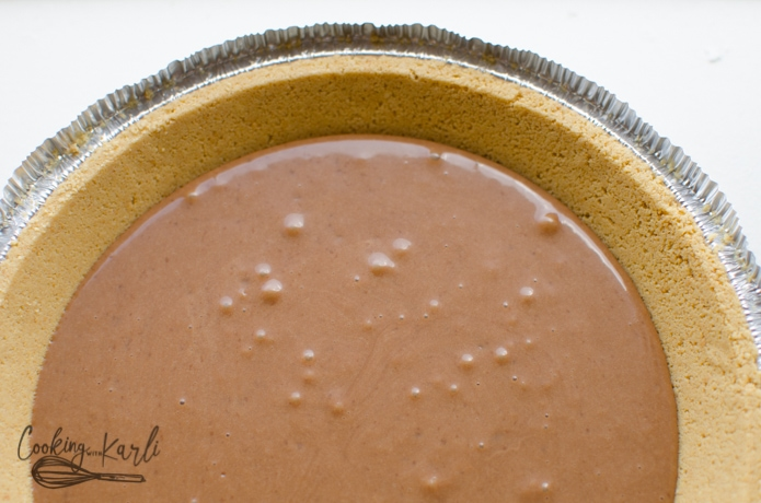 The chocolate layer poured into the pre made graham cracker crust.