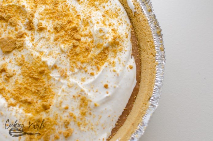 Graham cracker crust, chocolate layer and marshmallow layer topped with crushed graham cracker crumbs.