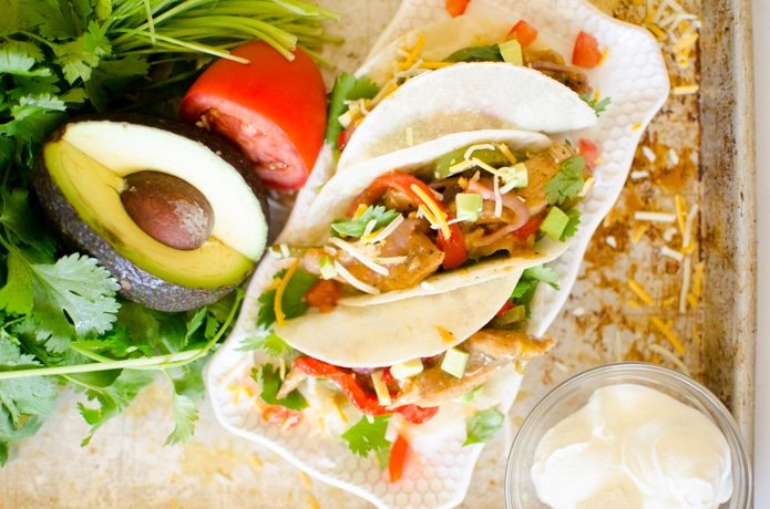 Seasoned chicken, sautéed veggies wrapped in a warm tortilla with cilantro and cheese.