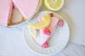 Frosted Raspberry Lemonade Pie sliced and served.