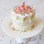 Small, easy smash cake for a first birthday covered in sprinkles.