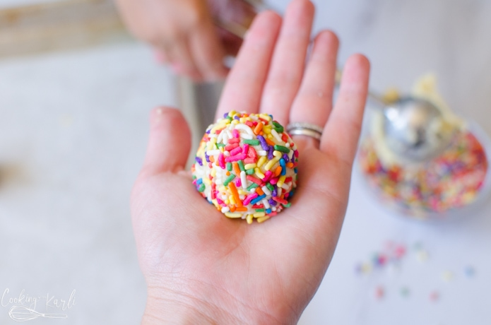 Cookie dough ball rolled in sprinkles.