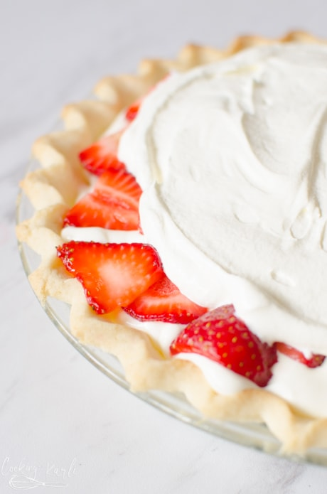 Fresh strawberries and a creamy filling on top of the crust is an easy pie recipe.