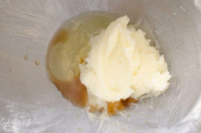 sugar, butter, egg white and vanilla in the mixing bowl.