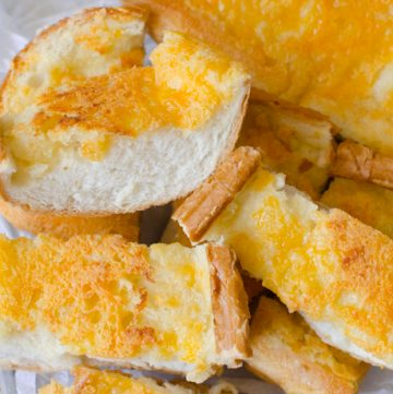 Garlic cheese bread is made from french bread, butter, garlic and cheese.