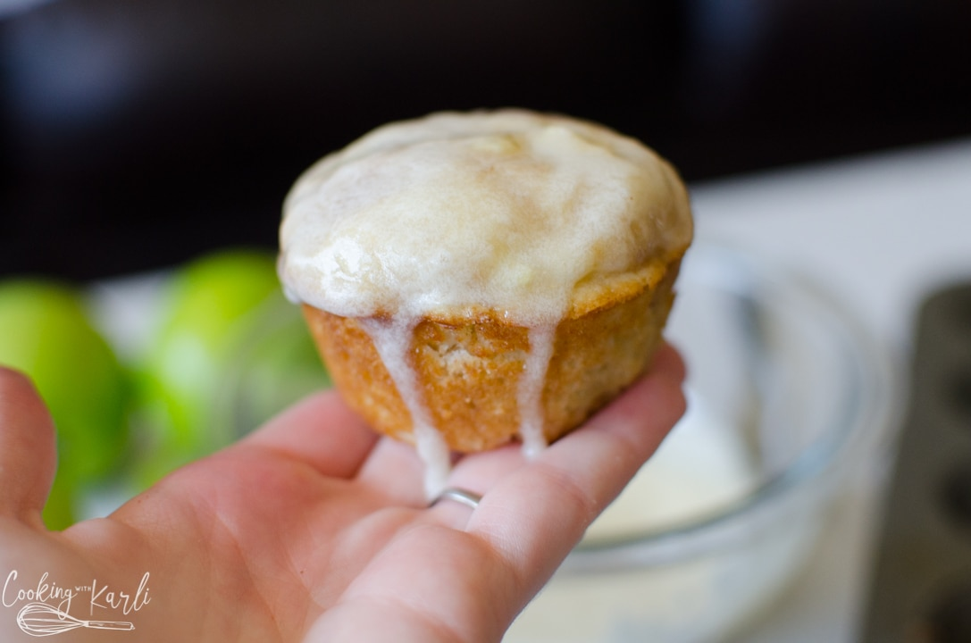 apple cinnamon muffin right after being dipped in glaze.