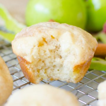 Apple Cinnamon Muffins are a soft and fluffy, made from scratch muffin. The basic batter is easy to make. The apple chunks and cinnamon swirl throughout the muffin make it the perfect Fall and Autumn breakfast snack or dessert. |Cooking with Karli| #fall #autumn #breakfast #apple #cinnamon #muffins #easy #fast #glaze #fromscratch #recipe #moist