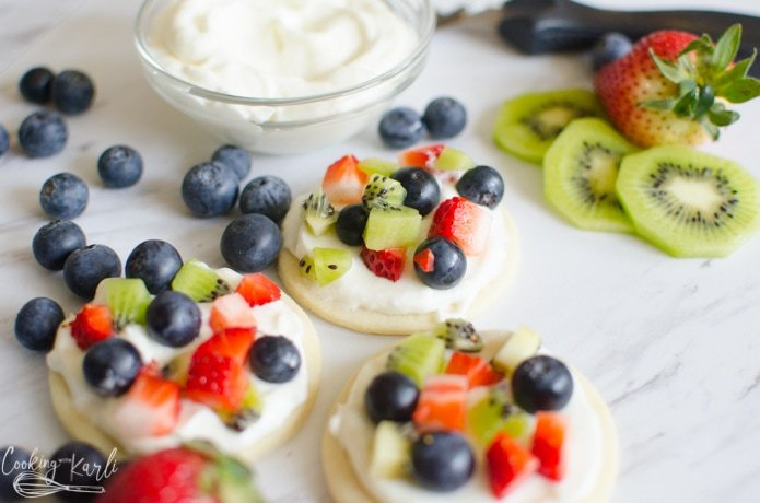 mini fruit pizzas made with sugar cookies and creamy vanilla frosting.