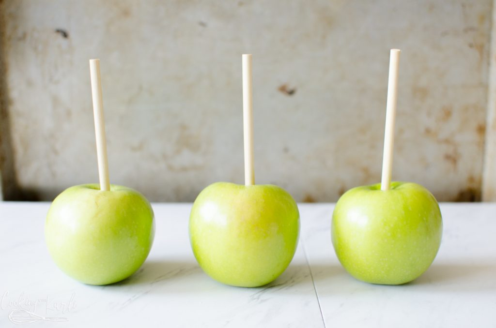 Sticks into the apples for the caramel apple