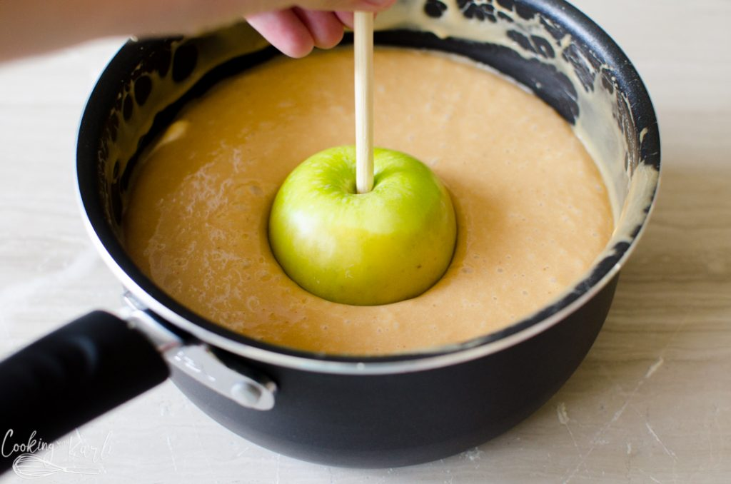 dipping apples in caramel.