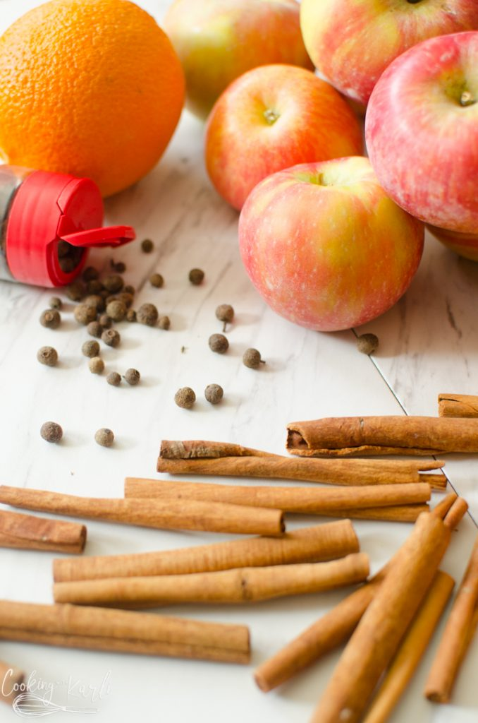 cinnamon sticks, apples, and orange and all spice.