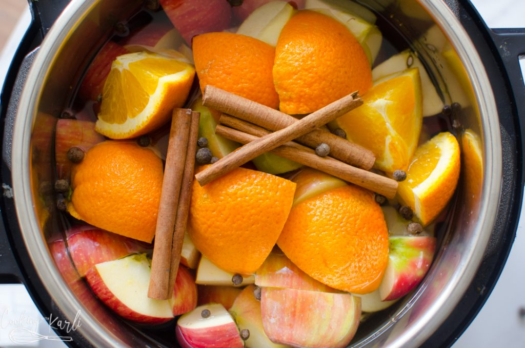 apples, orange, cinnamon sticks and whole all spice in the Instant Pot to make homemade apple cider.