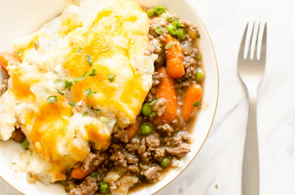 shepherd's pie made in the Instant Pot, dished up with the meat, gravy and mashed potatoes