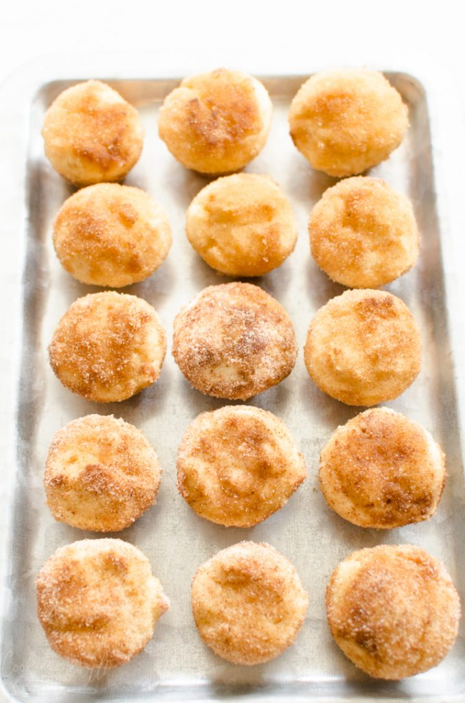 snickerdoodle muffins lined up on a serving tray