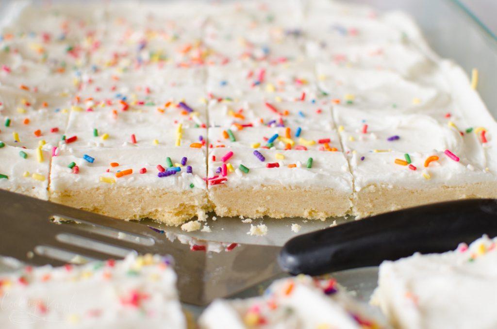 sugar cookie bars with sugar cookie frosting