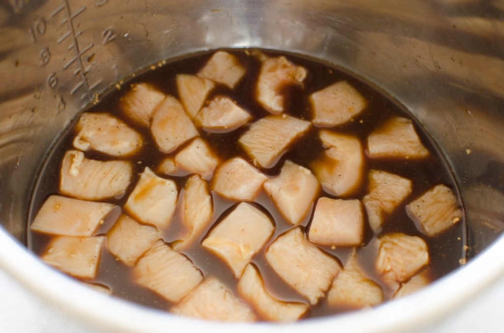 homemade teriyaki sauce and raw chicken chunks in the Instant Pot