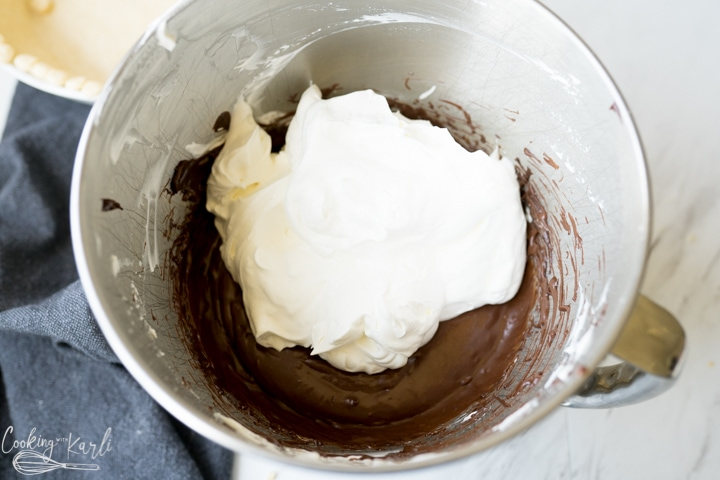 chocolate being folded with whipped cream for the chocolate pie