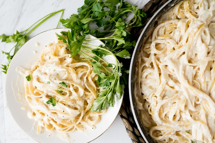 Alfredo Recipe with fettuccine noodles in pan and on plate