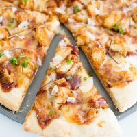 bbq chicken pizza sliced and served