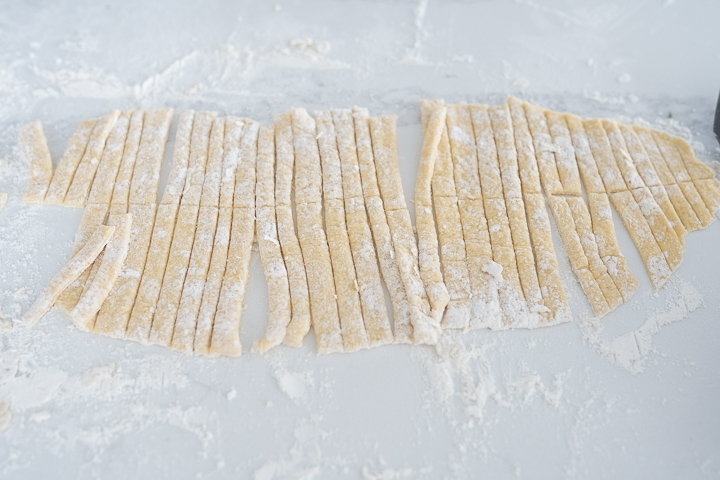 homemade egg noodles cut before being boiled