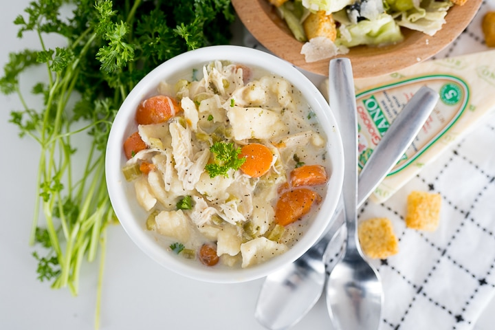 hearty creamy chicken noodle soup with homemade egg noodles served