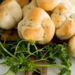 garlic knot with parsley, baked until golden brown and served on platter