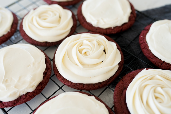 cream cheese frosting on red velvet cookies