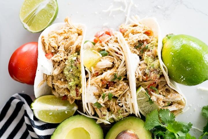 honey lime chicken inside of tortillas to make tacos.