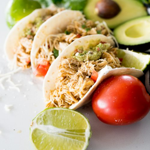 honey lime shredded chicken inside of tortillas for tacos