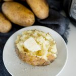fluffy baked potato made in the Instant Pot with butter