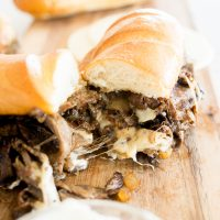 Philly cheesesteak sandwich cut in half