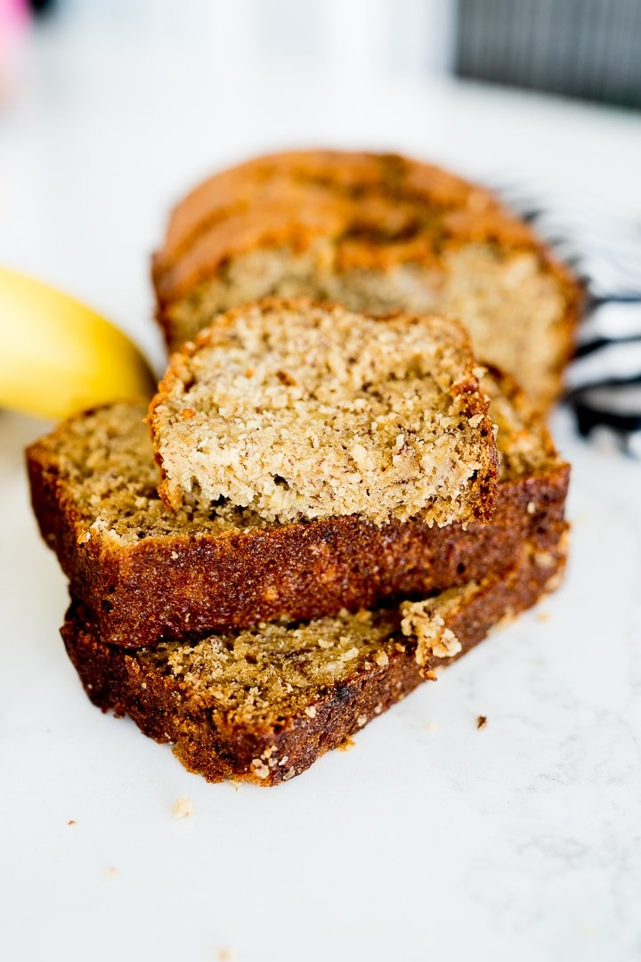 banana bread, sliced and cut, served