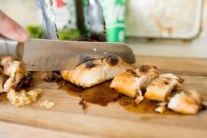 grilled chicken being sliced